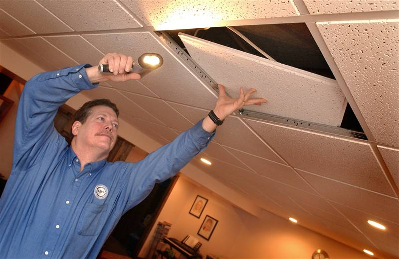 Lifting Ceiling Tile at an Inspection